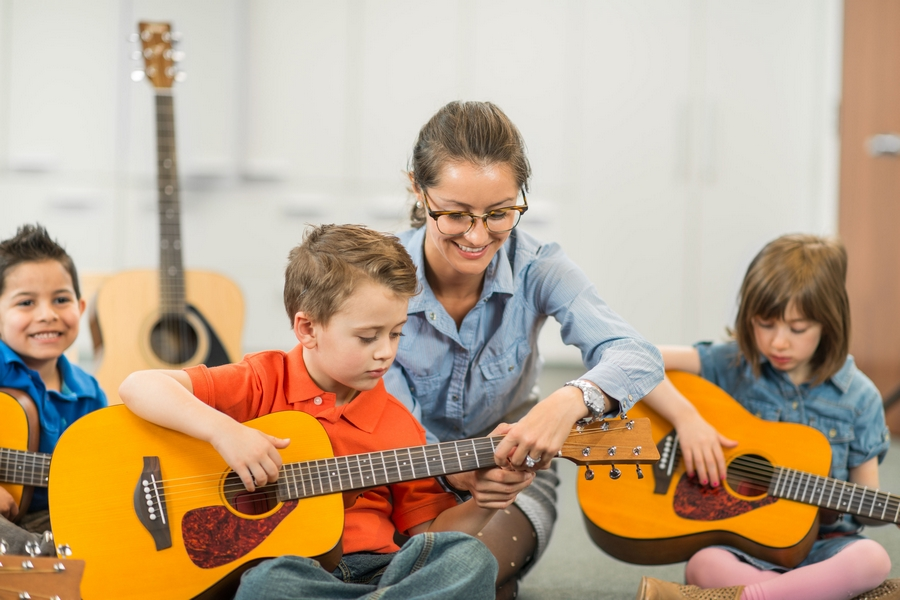 Kids music group plaing guitars