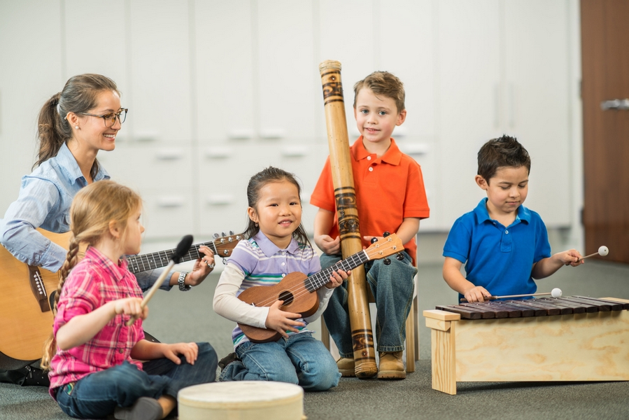 Diverse children playing different instruments