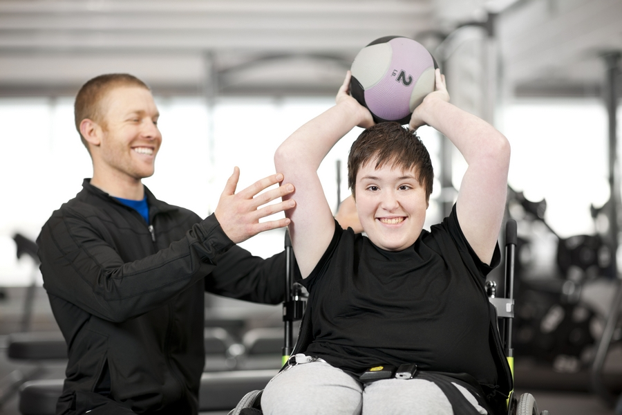 Disabled girl working out with her trainer